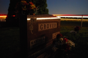 Taken in the Rowley cemetery under an August full moon and a car going past, this is the tombstone of Martha & Devere Grover...my grandparents.
